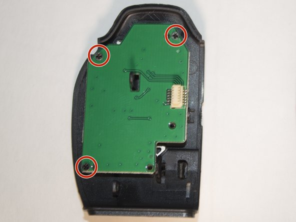 Image 1/2: Remove the three 4 mm Phillips #1 screws holding the circuit board in place.