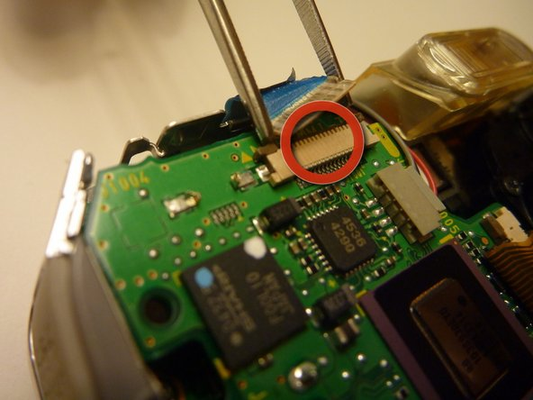 Image 2/2: Be careful not to rip the wiring tape with the tweezers.