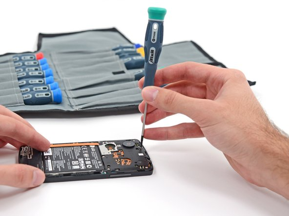 Image 3/3: The vibrator is held in place with only a small amount of adhesive. That means an easy repair, should your phone lose its ability to [http://www.youtube.com/watch?v=ZD1VKanLO3I|shake it up].