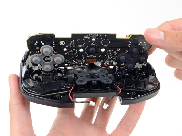 Image 1/2: A, B, see the D-pad come out of the Shield.