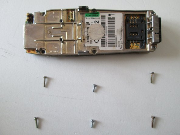 Notice that two of the screws are of different dimensions and colors when compared to the other four(picture three). Keep that in mind when re-assembling.
