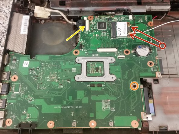 Remove the single screw securing the motherboard to the base.