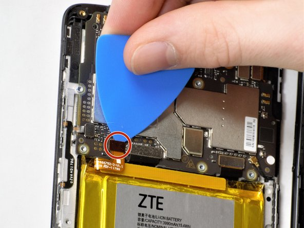 On the top left of the battery, flip the metal clips with a pick and remove the battery ribbon from the shell.