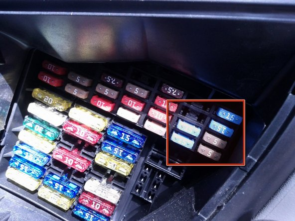 Image 2/3: Use the reference card and the white plastic tweezers attached to the back of the fuse cover to locate and pull out fuses responsible for headlight bulbs. Fuses 18 and 19 are for high beam bulbs; 20 and 21 - for low beam; 22 and 23 - for parking lights.  Pull fuses one by one so as not to mix them up.