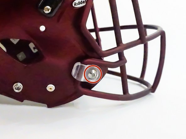 Using the Riddell Quick Release tool (or a suitable alternative) press the center button of the quick release fastener to unlock the attachment.
