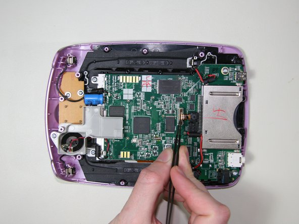 Use flat tweezers or fingers to pull the rear camera ribbon cable out of the motherboard's camera connector.