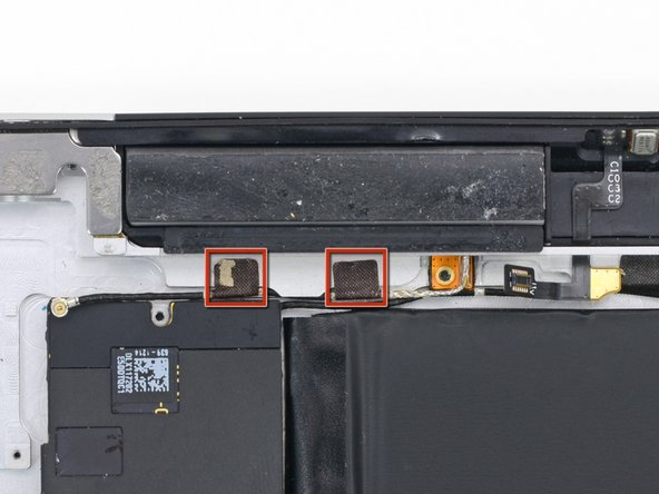 In this step you will remove the two pieces of tape securing the cellular data antenna cable to the rear case.