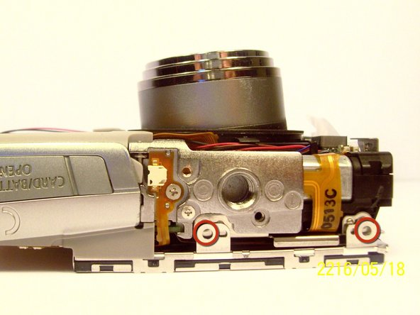 Remove the two screws that connect the LCD and backlight to the main body of the camera.