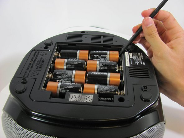 Image 1/2: Repeat until all eight batteries are removed.