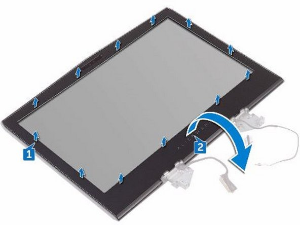 Carefully lift the display bezel and turn it over.