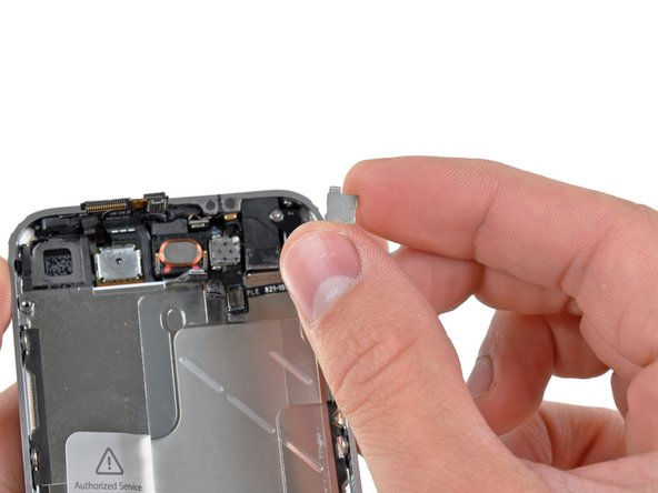 Image 2/2: Remove the front camera retainer.