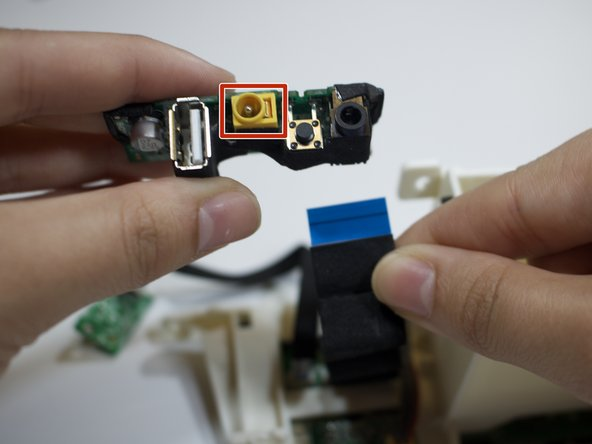 Locate the circuit box containing the yellow charging port.