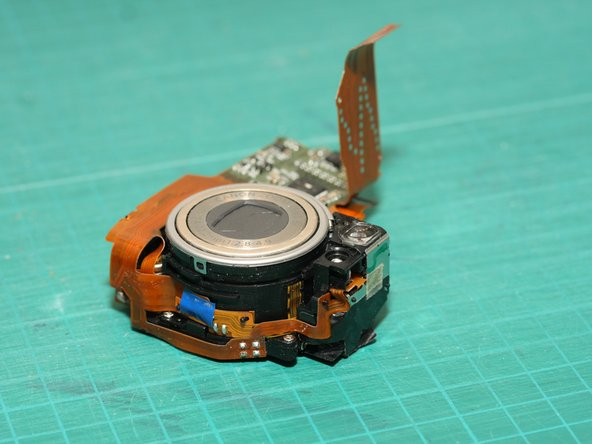 Here's a view of the lens module after removing the flash module. That's the optical viewfinder towards the right of the unit.