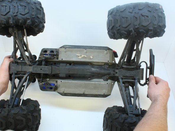 Flip the car on its back to provide access to the steering assembly.