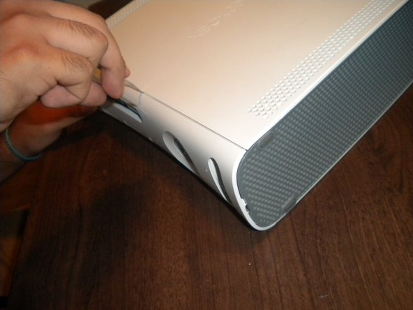 Remove the white plastic casing covering the Xbox.
