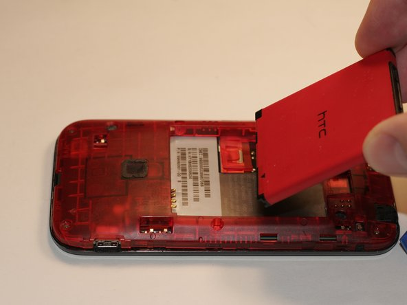 Remove the red battery to replace.