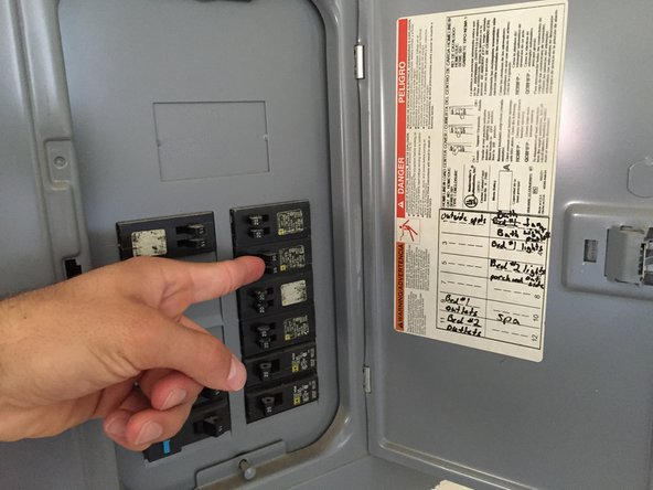 Find your circuit breaker panel and turn off the breaker that corresponds to your ceiling lights.