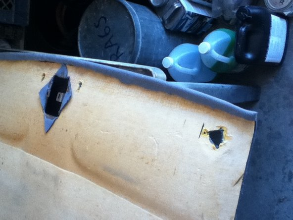 Image 2/3: Cut the side edges flush with the board. Also cut any access holes for the sun visors and other accessories that were previously removed.