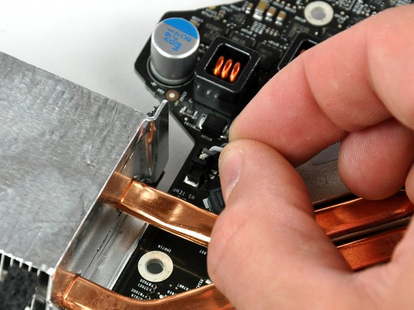 Turn the logic board over so the copper heat sink is facing up.