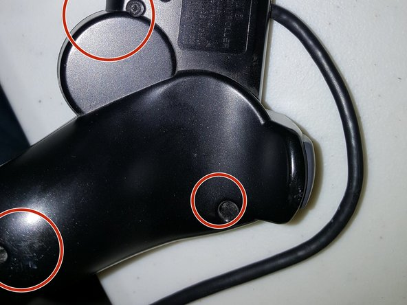 There are 6 screws that you will want to remove on the back of the Dualshock 2 controller. All pictures show the same thing essentially, but because of Ifixit's odd picture cropping system, every screw appears at least once throughout the 3 photos.