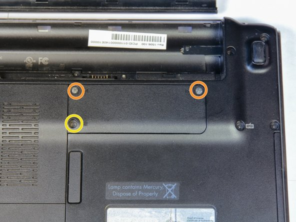 With the laptop upside down, locate the three screws on the wireless card cover and unscrew the screws.
