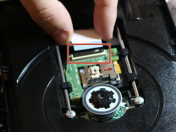 To remove the ribbon cable, flip down the black bar located on the connector.