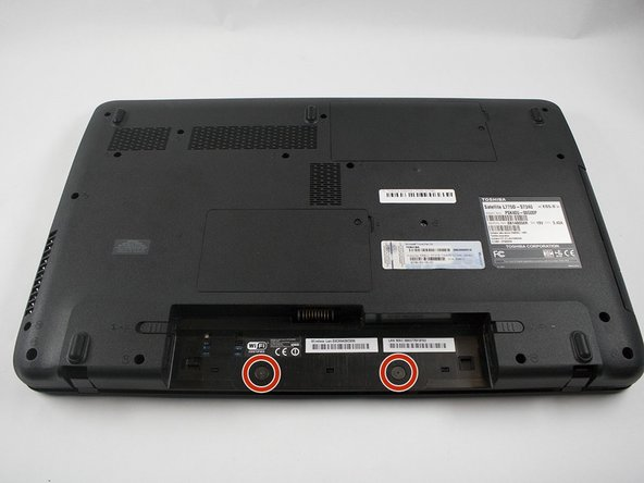 Remove the two screws from the underside of the laptop where the battery was located using the Philips #1 screwdriver.