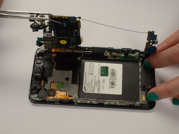 Image 3/3: Gently lift the panel from the back of the phone.