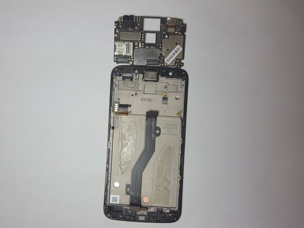 Use the Spudger to lift up and remove the Motherboard from the phone.