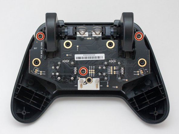Remove three 7mm T7 screws that fasten the logic board to the top half of the controller.