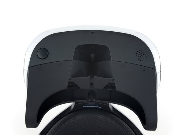 """Image 2/3: Sony's unique hanging visor design presents an all-new solution to the problem of adjusting eye relief. Just hold the button (above the cute PlayStation button symbols) and slide the """"scope"""" forward or back to change the focus."""