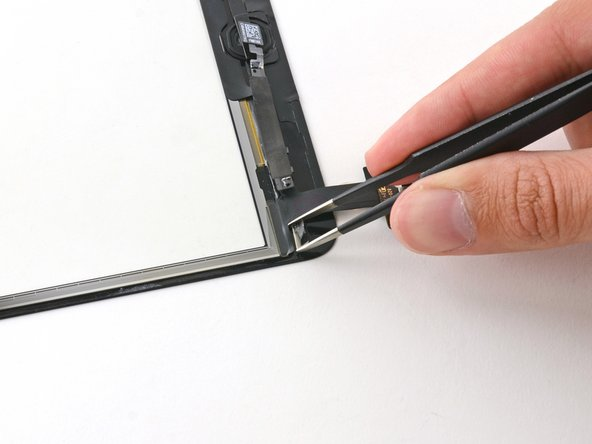 Use a pair of tweezers to carefully place the upper left smart cover magnet in place.