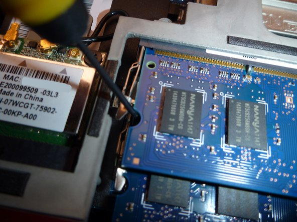 Image 1/3: Carefully pull the RAM module to remove.