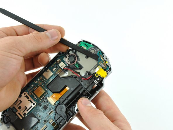 Image 1/1: Remove the power switch board from the PSP.