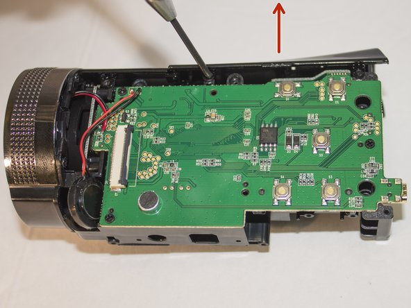 Push upward on the top panel to remove it from the body of the camera.