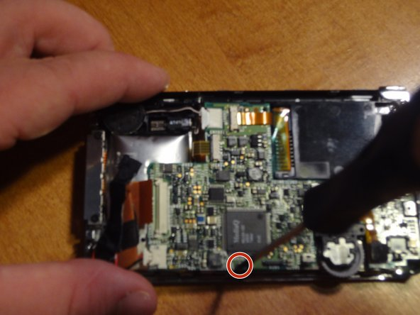 Remove one screw located on the board below the battery.
