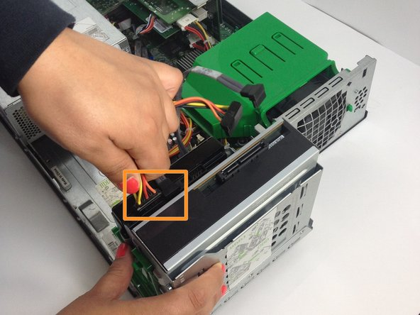 Repeat the same process to remove the two cords connected to the Hard Drive.