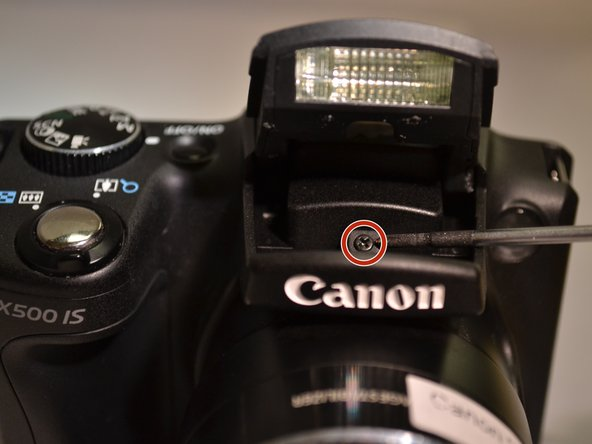 Using the Phillips 00 screwdriver, remove the 4mm mounting screw from underneath the flash.