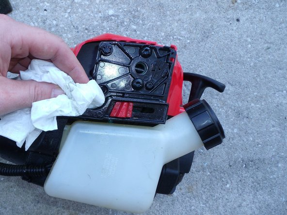 Wipe all oil and water residue around the air filter casing with a paper towel or rag.