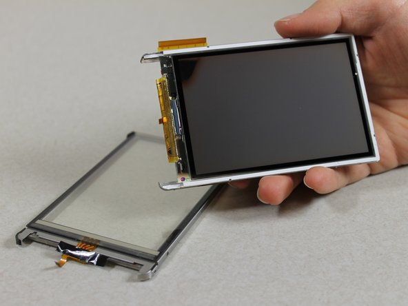 Image 1/3: Use a Slot SL1.5 screwdriver to pry the touchscreen shell from the display component using the 4 slots around the entire component
