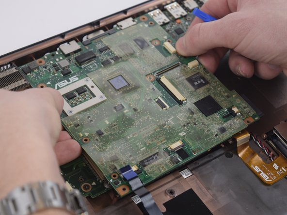 Slowly lift the motherboard up towards you being careful as to not rip any cords out of the bottom.