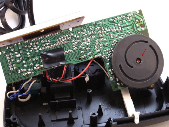 Image 1/2: Using a Phillip's #01 Screwdriver, unscrew the one 3mm screw from the middle of the AM-FM switch dial.