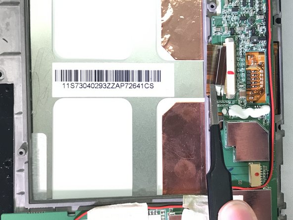 Use tweezers to grasp the ribbon cable, then pull the cable to disconnect it from the device.
