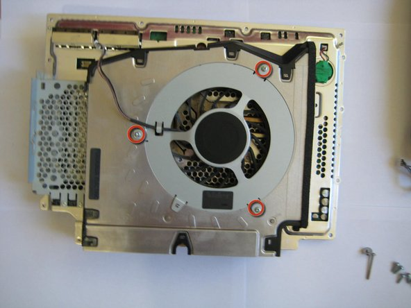 Image 1/3: Remove the 3 Philips #2 screws holding the fan to the main body.
