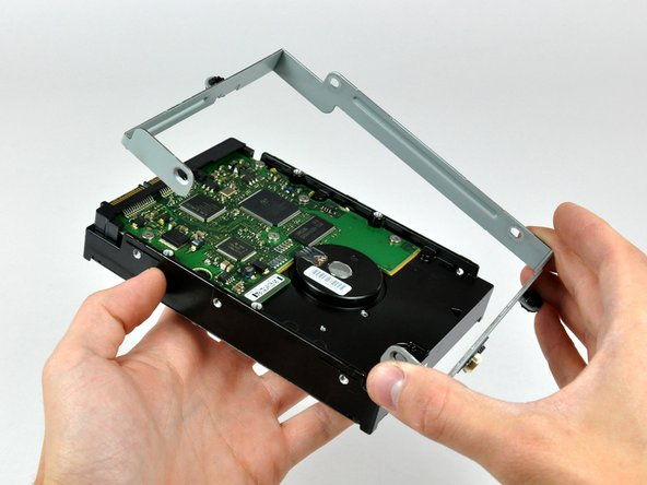 Lift the hard drive bracket off the hard drive.