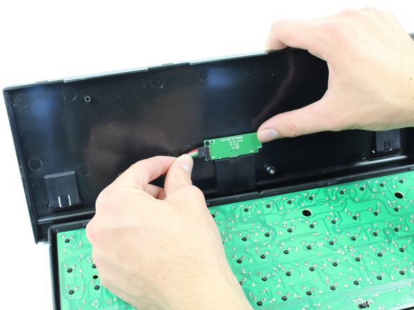 Detach the 4-pin cable from the bottom panel of the keyboard.