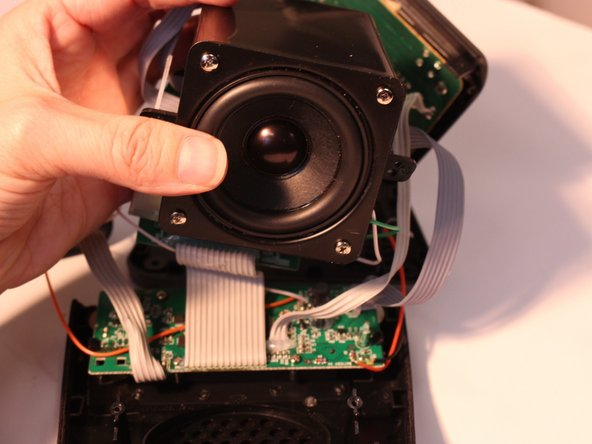 Image 1/2: Remove four 7mm screws to detach speaker from speaker assembly