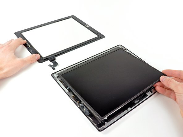 Image 2/2: Lift the LCD from its long edge farthest from the digitizer cable and gently flip it toward the rear case—like closing a book.