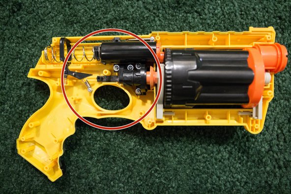 Check the inner chassis around the trigger area. Make sure the springs and parts can move freely.