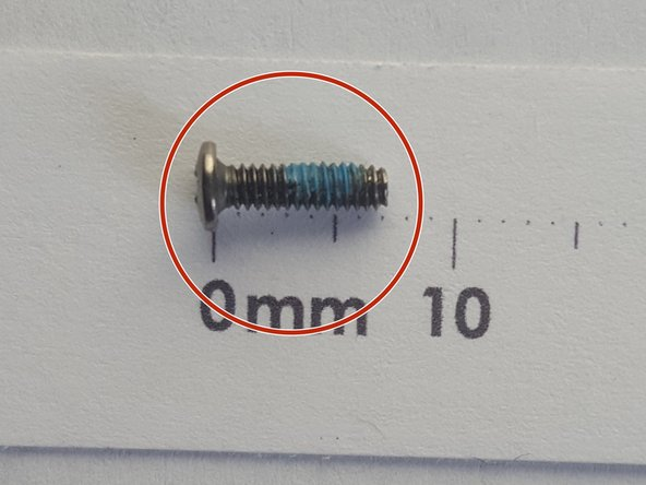 Remove two 7mm PH01 screws
